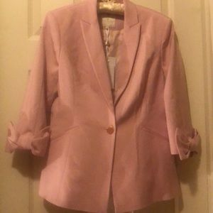 Light pink blazer bow on the sleeve by Ted Baker.